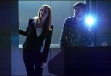 Jennifer Finnigan and Charlie Rowe look for hidden clues. Salvation/CBS